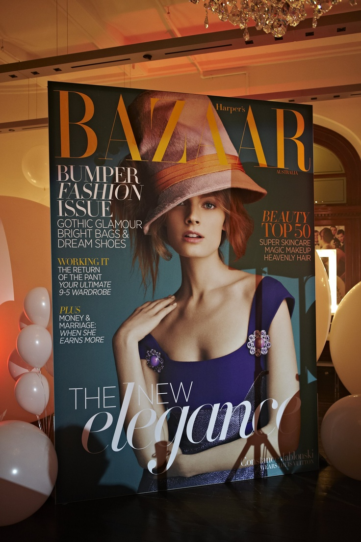 Oversize Harper's Bazaar cover at 30 Days of Fashion & Beauty Launch night.