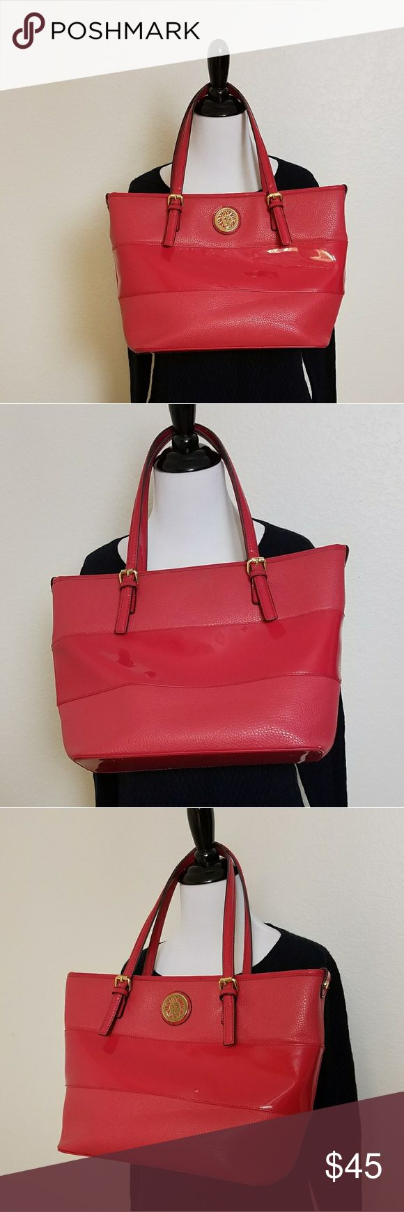 Anne Klein Pink Patent Leather Shoulder Bag Tote Good condition, some wear on the handles, the body inside and out is in great condition (small mark on the back top in the middle - see photo)  Inside is 3 sections: middle section zips closed, front side has 2 slip pockets, and on the back there's small zipper pocket    Inside is lined with a navy and cream polka dot fabric  Perfect for work! Could fit a small laptop or tablet.   Measures approximately 16 inches across and 10 inches down with…