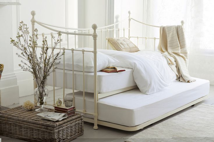 """""""Hastings"""" metal daybed in ivory with curved design from Laura Ashley."""