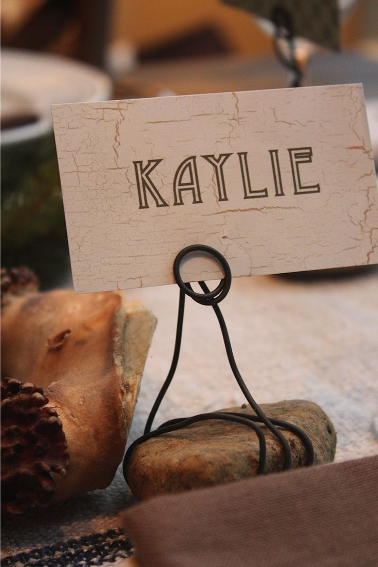 Handmade Placecard Holders for casual fall dinner party using rocks wrapped  with wire. love this
