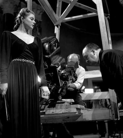 Ingrid Bergman and director Alfred Hitchcock on the set of Notorious (1946).