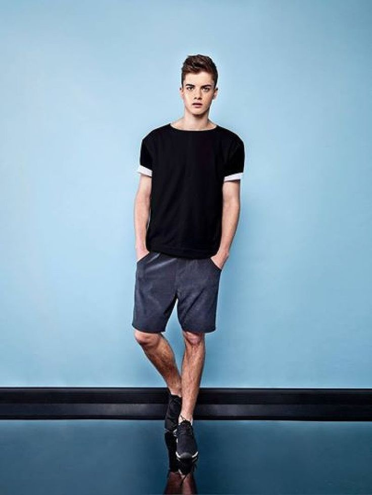 Wear a black and white crew-neck t-shirt and dark grey shorts to create a great weekend-ready look. For footwear go down the casual route with black athletic shoes.   Shop this look on Lookastic: https://lookastic.com/men/looks/black-and-white-crew-neck-t-shirt-charcoal-shorts-black-athletic-shoes/12417   — Black and White Crew-neck T-shirt  — Charcoal Shorts  — Black Athletic Shoes