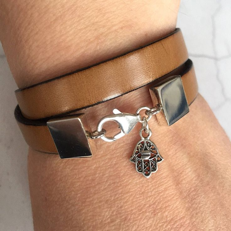 Beige leather and sterling silver Hamsa hand bracelet #leatherjewelry #hamsahandcharm #hamsahandbracelet #positiveenergy #wellbeing #protection #luckbracelet #leatherbracelet #fashionaccessories #womensaccessories #mensaccessories #fashion #style #accessories #hamsajewellery #goodvibesbracelet #hamsabracelet A personal favourite from my Etsy shop https://www.etsy.com/uk/listing/564896846/hamsa-hand-bracelet-sterling-silver