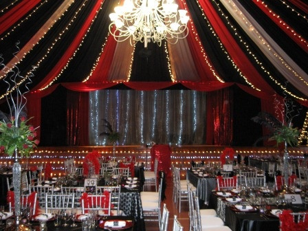 red, black and white draping with fairy lights. I love the addition of the fairy lights as it really draws the eye up.