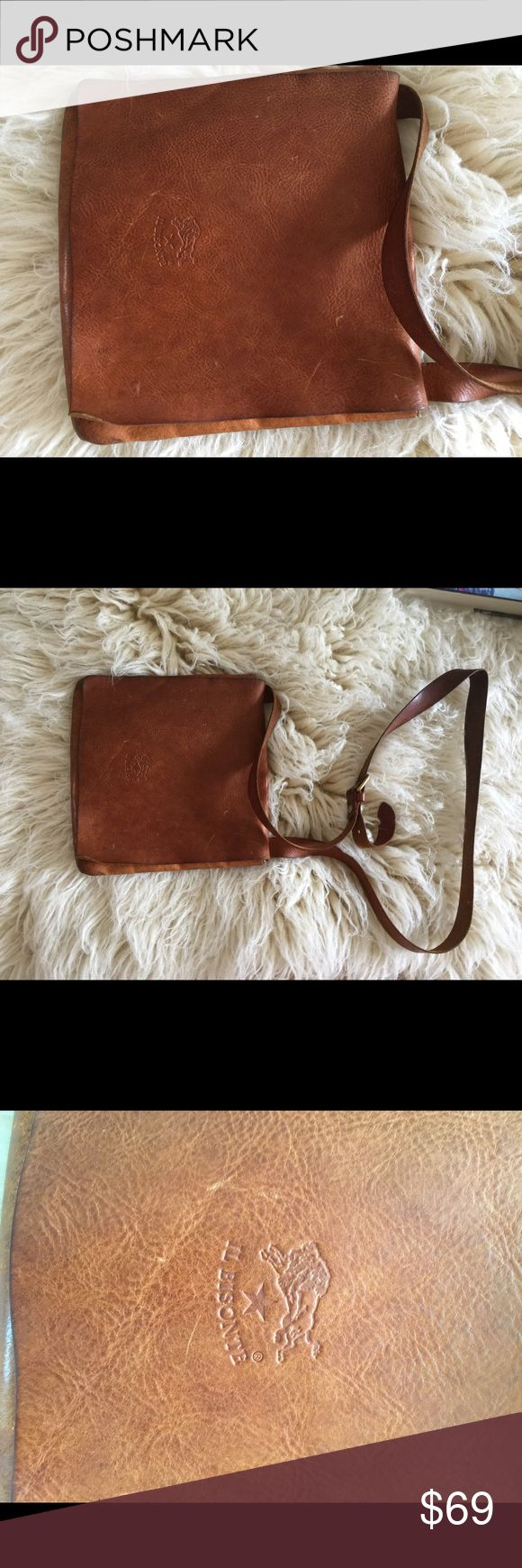 Il Bisonte brown leather Crossbody bag! Il Bisonte brown leather Crossbody bag!  Bag is well worn and has signs of wear!  Could use a good cleaning! Small rip in interior. Please see all pictures. Still life left in this bag with some love and care! Il Bisonte Bags Crossbody Bags