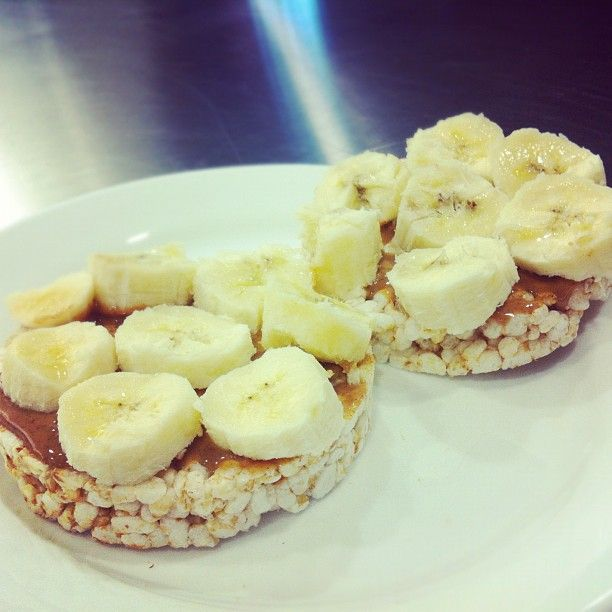 Healthy Breakfast Peanut Er And Banana On Rice Cakes