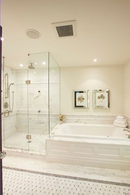 Mirrored frame artwork turns on the glam above this soaker tub for two.