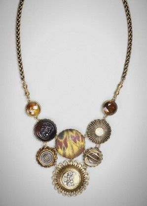 Algiers necklace: Bib created with vintage glass cabochons, one antique metal button circa 1880-1900, a Swarovski crystal, and a new Czech glass button.