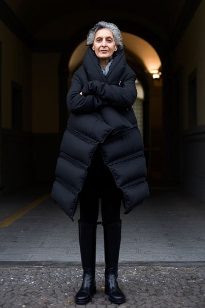 """Apparently Norma Kamali invented the puffer for women: After splitting with her husband, Mohammed (Eddie) Kamali, in the mid-1970s, she took to camping in the woods with a boyfriend. """"It was cold,"""" she recalled, """"and I was always getting up at night to go to the bathroom."""" On one particularly nippy night, she threw on her sleeping bag and sprinted for the bush. """"As I was running,"""" she said, """"I was thinking, 'I need to put sleeves in this thing.' """" Ruth La Ferla for The New York Times"""