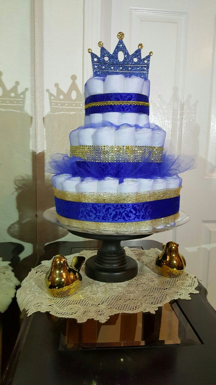 Prince theme diaper cake. Royal blue and gold perfect for your little prince. Follow us at magnolia_diaper_cakes