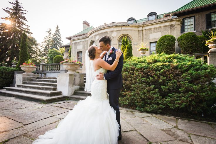 Bride and groom kissing in front of the Parkwood Estates   Toronto Wedding Photographer Pedram Navid