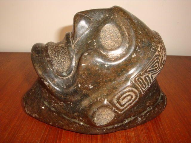 Taino grote Antillen - Macorix head - antropomorfe sculpture - gesneden platen en gepolijste zwarte steen - hoogte: 180 mm lengte: 140 mm breedte: 100 mm gewicht: ca. 4/5 kg  Taino grote Antillen - Macorix head - antropomorfe Sculpture-Zeer harde zwarte steen gesneden gebeiteld en gepolijst.Hoogte: 180 mm lengte: 140 mm breedte: 100 mm gewicht: ca. 4/5 kg.Het vertegenwoordigt een menselijk gezicht onder invloed van hallucinogenenMond en ogen staan wagenwijd open.Grote neusgatenDe oren zijn…