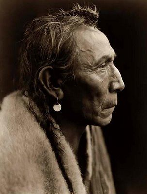"This picture was taken by Edward Curtis in 1927. The Indian's name was ""Two Guns"". Curtis traveled the country in the late 1800's and early 1900's documenting Native Americans through his photography. His pictures have become treasures giving us a glimpse into traditional Native American life."