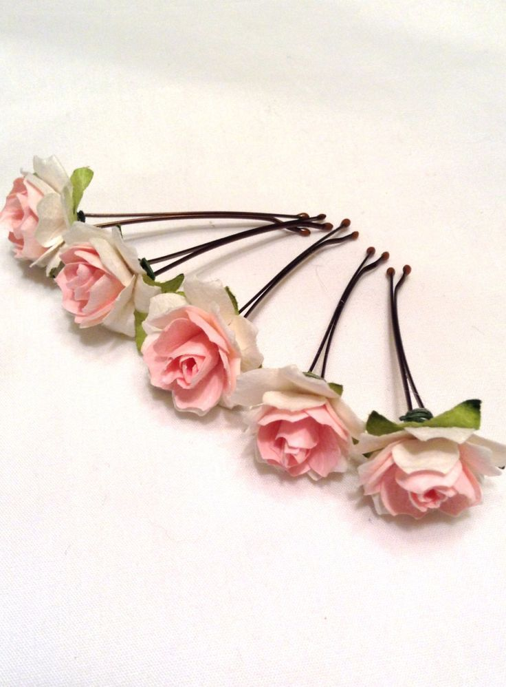 Delicate pink roses with hints of green leaves adorn metal hair pins. These hair pins are perfect for weddings including bridesmaids and flower girls, birthdays or and other special occasion. Each pin