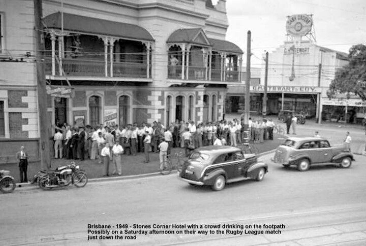 Stones Corner Hotel, 1949 - A big crowd of people are drinking on the footpath. Possibly on a Saturday afternoon on their way to the Rugby League match just down the road (description given with photo). My father's families old area and his older brother's stopping ground, this pub. His brother is most likely in this photo, as he was 21 at this time. He still goes down to this hotel 3 times a week to see his mates.