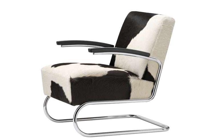 Thonet S411 - S412. Fauteuil met een verchroomd sledeframe en een hoog zitcomfort. De S411 kan bekleedt worden in het stof, koeienhuid, leder of Nappaleder. http://www.meinema.nl/thonet/
