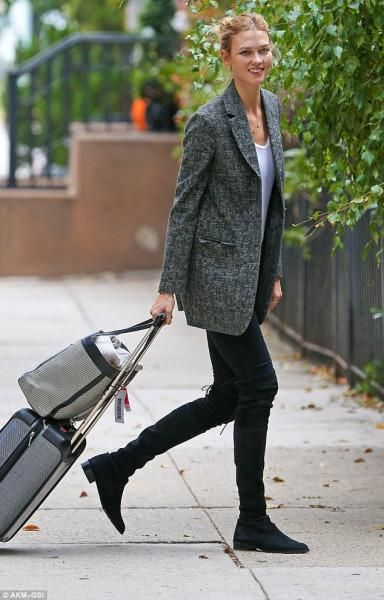 39cde9028c903 Karlie Kloss wearing Stuart Weitzman Lowland Boots and Tumi Tegra-Lite  Carry-on Luggage