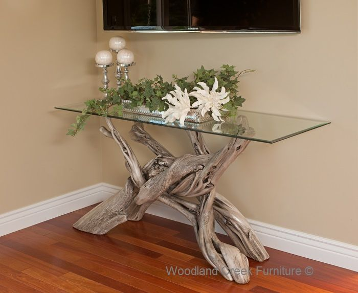 A solid wood natural live edge slab is handcrafted into a soft modern sofa  table and features a built in organic lamp. Custom sizes. Natural wood  furniture.