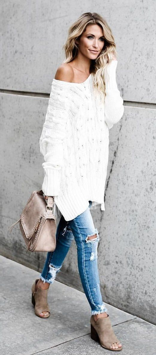 Cute off the shoulder white knit sweater with distressed jeans.