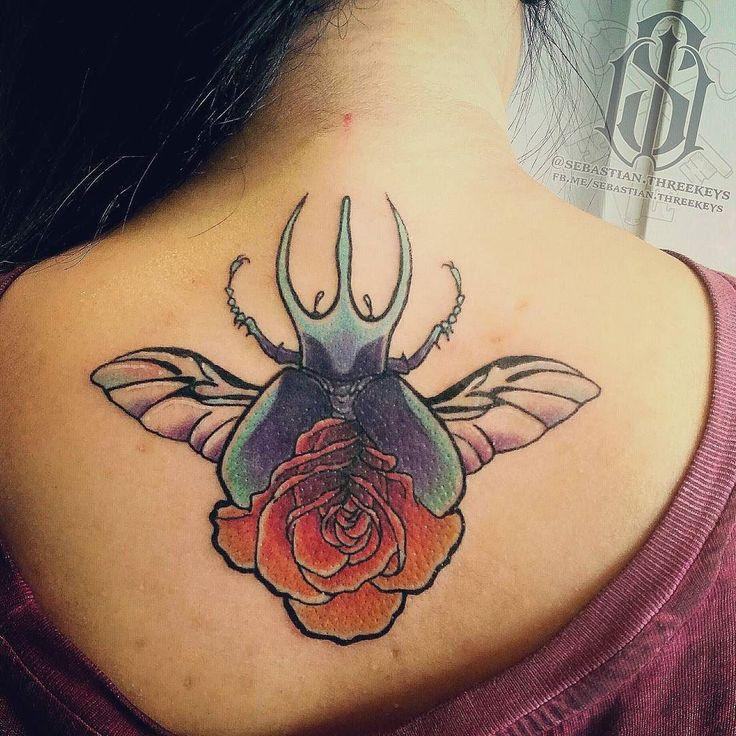 Had fun yesterday tattooing @xmaskitty with my scarab rose design. It was an absolute blast here @jollyoctopustattoos. . . . #customtattoodesign #customtattoo #oneofakind #customtattoodrawing #oneofftattoo #oneoffpieces #jollyoctopustattoo #jollyoctopustattoos #thejollyoctopus #jollyoctopustattoosandpiercings #tattooartist #tattooartistmagazine #neotraditionaltattoo #backtattoo #neotradtattoo #scarabtattoo #rosetattoo #somuchfun