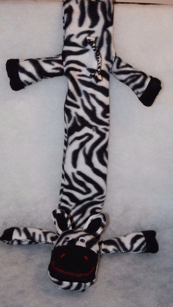 """Zebra Handmade Pediatric Stethoscope Covers with zebra face and tail. 28"""" over all length. 3-7/8"""" body width not including legs. Polar fleece fabric with embroidered features and goggle eyes. Head, legs are filled with polyester fiberfill. Elastic at top with Velcro closure at top and bottom. * Machine wash cold on gentle cycle or hand wash. Hang dry or tumble dry on low heat. ** If you purchase more than one of my auctions I can do combined shipping for US Destinations only. If that is…"""