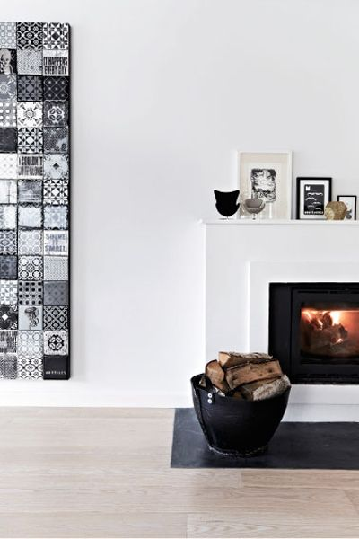 A Dreamy Nordic Home | NordicDesign - Like this overall look. Can't tell if the artwork on right is collage of tiles or print but it is lovely. Great idea to use a leather basket to hold the chopped wood.
