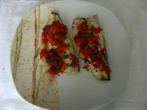 Filetti di branzino al forno con pomodorini