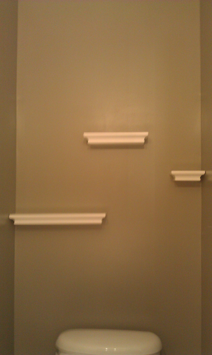 Floating shelves in the powder room hung with Command Strips by 3M.