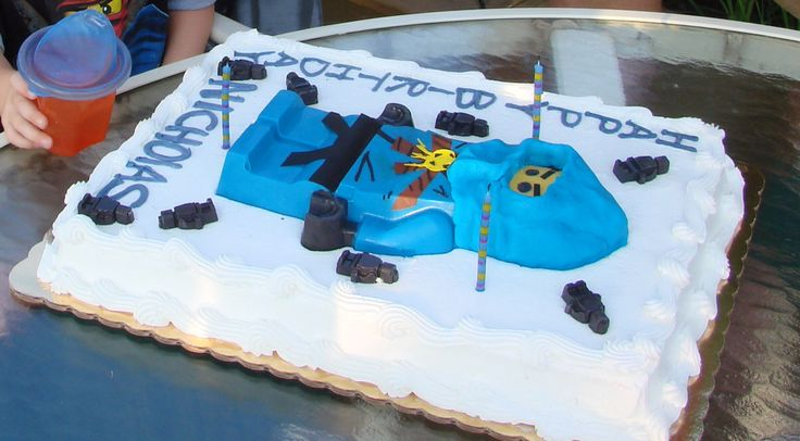 Last years birthday cake - 3 year old was fascinated by Ninjago, and the color blue, so I made him his favorite ninja - Jay.  Made out of chocolate, sugar sheets, blue fondant.  Used mini lego ice cube tray to cast chocolate mini figures.