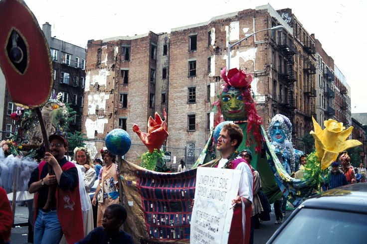 Procession with vacant buildings that were prevalent throughout the Lower East Side through the late 1990's. Volunteer carries Land Trust Petition in 1995. Photo by Vince Eng.