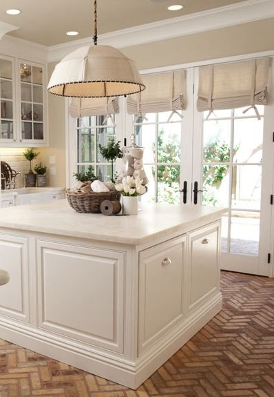 Cool Flooring Ideas For The Kitchen The Herringbone Brick Floor Is Beautiful In This Otherwise White And Cream Kitchen