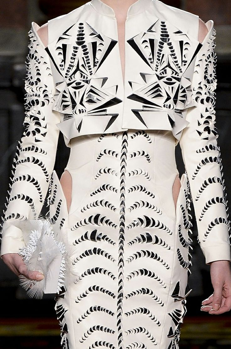 Innovative textiles design for fashion - leather dress with symmetrical 3D patterns using cut, fold repetition; artful fabric manipulation // Iris van Herpen