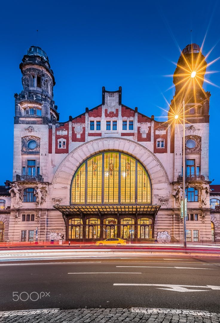 Golden station - Beautiful portal of old building of Prague main railway station. This building was built in art nouveau style in 1901-1909 and designed by Czech architect Josef Fanta.