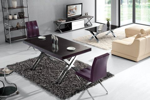 """The Vala Print Dining Table has a unique modern style. It's top-quality glass sits on a crocodile eggplant print with stainless steel x-design legs.  Dimensions: 5'3"""" x 3' x 2'6""""H"""