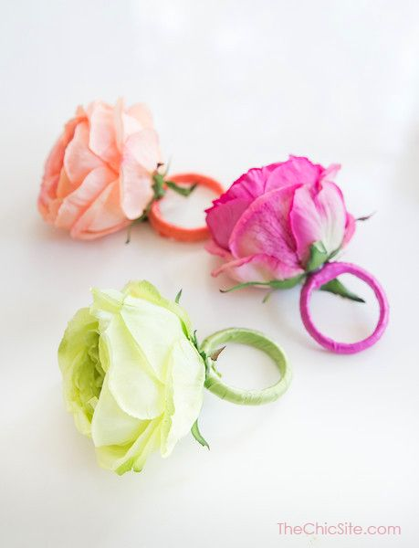 DIY Flower Napkin Rings ~ This party decor craft screams Spring. All you need for this craft are shower curtain rings, ribbon and flowers in fun Spring colors. These beautiful rings will dress up any napkin in Chic style.