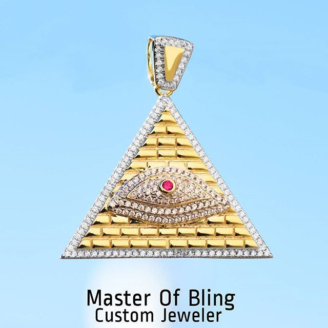 """#mulpix The Egyptian """"Eye of Horus"""" also known as the """"Eye of Ra"""" in ancient Egypt is the symbol of royal power and protection. Get the all powerful all knowing sterling silver eye pendant SKU:351625490946 www.masterofbling.com   #sterlingsilver  #ruby  #rubyeyes  #pyramid  #egypt  #egyptain  #eyeofhorus  #goldfinish  #14k  #icedout  #labdiamonds  #labmade  #ancient  #ethnic  #ethnicwear  #mensfashion  #streetwear  #customjewelery  #freshdesign  #masterofbling  #hotfashion  #hiphop"""