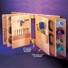 """Flip-through tool storage. Plywood """"leaves"""" swing from standard door hinges, allowing quick and easy access to tools. Wall space is always at a premium. Build this booklike storage rack, and expand your wall space exponentially. Grabbing a tool is as easy as flipping through a magazine.    Mount two parallel 2x4s on the wall spaced 24 in. apart. Cut the leaves from 3/4-in. plywood and hang them from the 2x4s with 3-in. door hinges."""