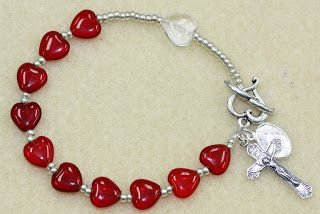Heart Rosary Bracelet: Easy Tutorial from Bead World! Learn to make this easy DIY crimping jewelry project. Adorable for Valentine's Day! If you're not religious, just change the charms!