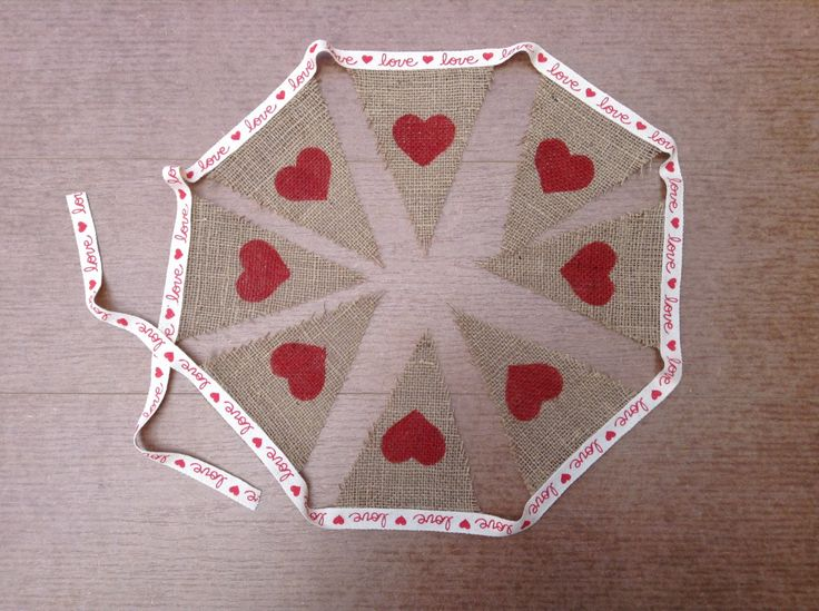 A personal favorite from my Etsy shop https://www.etsy.com/listing/234730913/burlap-love-pendant-bunting