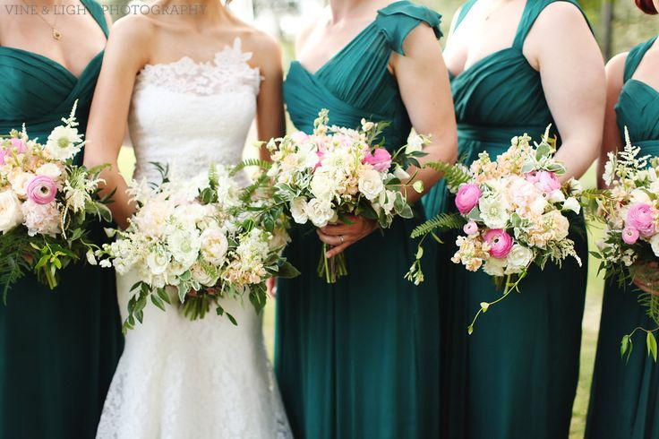 bridesmaid bouquets of light pink peony, peach stock, white scabiosa, white astilbe, snow on the mountain, light pink ranunculus, white majolik spray rose, plumosa, fern & jasmine vine are a standout against emerald green gowns.