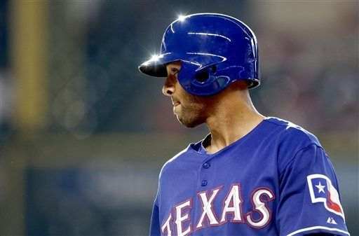 In his first game as a Texas Rangers' Alex Rios takes a walk against the Houston Astros in the 2nd inning of a baseball game, Saturday, Aug. 10, 2013, in Houston. (AP Photo/Pat Sullivan)