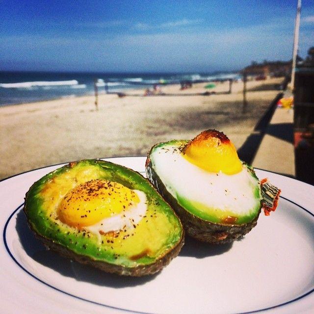 Over easy eggs in avocado halves