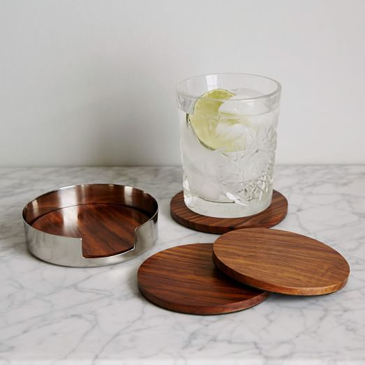 Serve and protect. Made from stainless steel and sheesham wood, these Mid-Century Coasters bring a vintage-inspired touch to coffee tables, dinner tables and consoles.