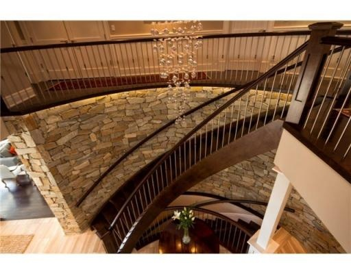 Stone walls, beautiful stair case and chandelier