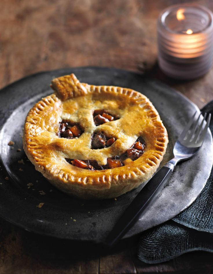 Spooky Beef Pies ~ individual pot pies with Jack-o'-lantern faces cut into shortcrust pastry tops | from ASDA Recipes