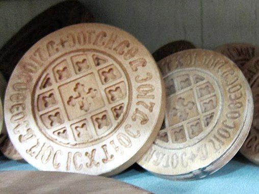 These wooden stamps are for Qurban, the holy Christmas bread served at the grand feast immediately after Coptic church services on Christmas night to break a traditional 43-day fast. Twelve small x's surrounding the cross represent the 12 disciples. Coptic Christmas is celebrated on January 7, which coincides with December 25 in the Julian calendar, which itself is derived from the ancient Egyptian calendar. About 95 percent of Egypt's Christians are Copts.