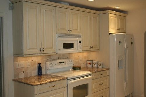 antique white cabinets with white appliances