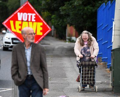 Before and after Brexit: Photo highlights of British politics in 2016:      Brexit:   Voters make their way towards a polling station to vote in the EU referendum in Belfast, Northern Ireland on 23 June 2016.   Charles McQuillan/Getty Images