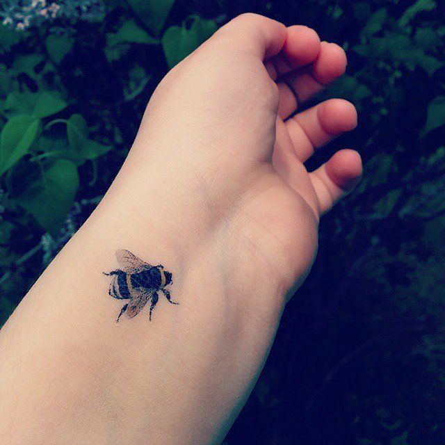 Check out these great small tattoo ideas like this bumble bee tattoo.