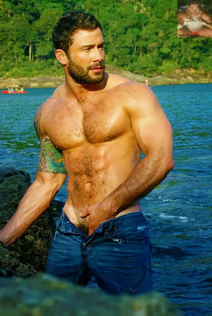Beautiful muscular and hairy man, just about to take a dip in the lake.